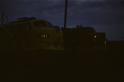 2016.020.02.1957-5--neubauer 35mm kodachrome--CMStP&P--EMD diesel locomotives at night--Savanna IL--1957 0427