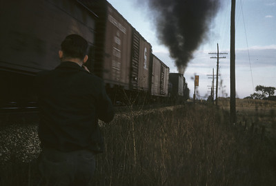 2016.020.02.1955-17--neubauer 35mm kodachrome--CMStP&P--steam locomotive 4-8-4 214 with freight train action crossing diamond--Duplaneville WI--1955 1000
