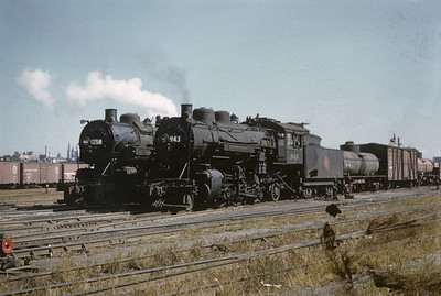 2016.020.02.1955-01--neubauer 35mm kodachrome--CMStP&P--steam locomotive 2-6-2 943 and 2-8-0 1258 in yard scene--Milwaukee WI--1955 1000