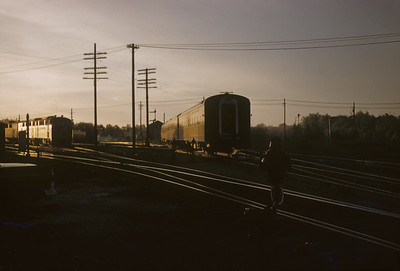 2016.020.02.1957-4--neubauer 35mm kodachrome--CMStP&P--EMD diesel locomotive on passenger train departing--location unknown--1957 0000