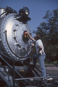 2016.020.52.03--jim neubauer 35mm kodachrome--BC&G--steam locomotive 2-8-0 14 getting number plate painted by Phil Weilbler--Dundon WV--1962 1000