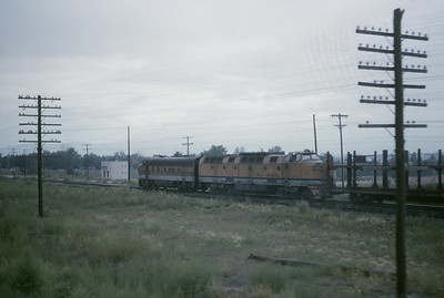 2016.020.54.08--jim neubauer 35mm kodachrome--D&RGW--EMD and Krauss-Maffei diesel locomotive on freight train seen from NRHS fantrip--location unknown--1963 0900