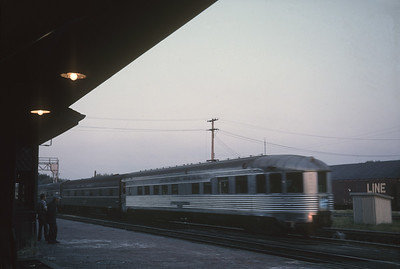 2016.020.20.21--jim neubauer 35mm kodachrome--NYC--obs-lounge car on hind end of passenger train 28 The Century departing station--Elkhart IN--1961 0900