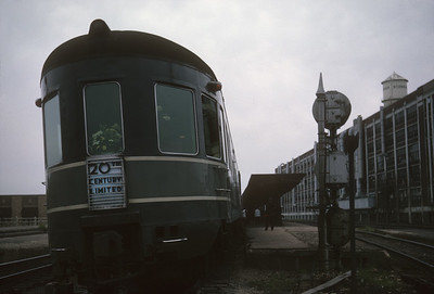 2016.020.20.24--jim neubauer 35mm kodachrome--NYC--obs-lounge car on hind end The Century passenger train at station platform--South Bend IN--1963 0500