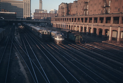 2016.020.20.32--jim neubauer 35mm ektachrome--NYC--EMD diesel locomotive 4057 on passenger train 28 departing station scene--Chicago IL--1968 1124