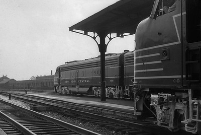 2016.020.20.06--jim neubauer 35mm monochrome slide--NYC--EMD diesel locomotive on two sections of 50th Anniversry 20th Century at station platform--Chicago IL--1952 0615