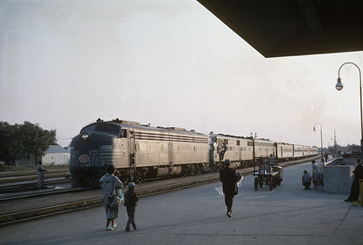 2016.020.20.19--jim neubauer 35mm kodachrome--NYC--EMD diesel locomotive 4069 on passenger train 28 The Century arriving at station--Elkhart IN--1961 0900