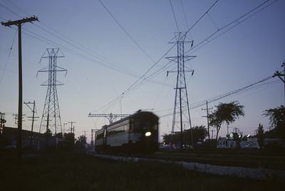 2016.020.16.10--neubauer 35mm kodachrome--CNS&M--electric interurban passenger train action at dusk--Skokie IL--19862 0621