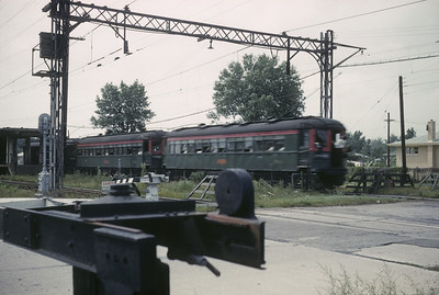 2016.020.16.03--neubauer 35mm kodachrome--CNS&M--electric interurban passenger train action putting trolley pole up--location unknown--1961 0800
