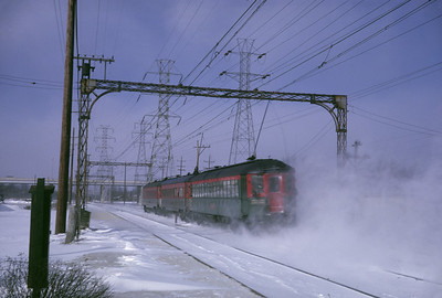 2016.020.16.15--neubauer 35mm kodachrome--CNS&M--electric interurban at speed in snow action last day of operations--Briargate IL--1963 0121
