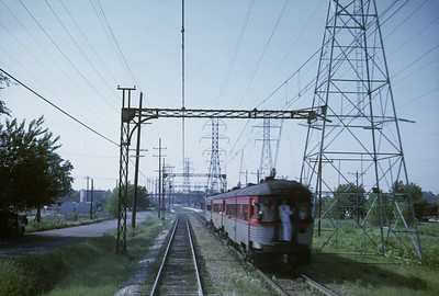 2016.020.16.09--neubauer 35mm kodachrome--CNS&M--electric interurban passenger train action--location unknown--1962 0600