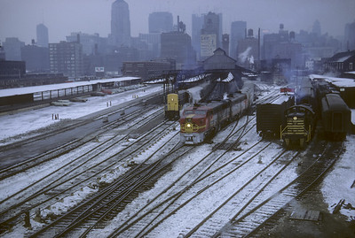 2016.020.07.08--jim neubauer 35mm kodachrome--AT&SF--ALCO diesel locomotive on Grand Canyon Ltd passenger train departing Dearborn Station scene--Chicago IL--1967 1230