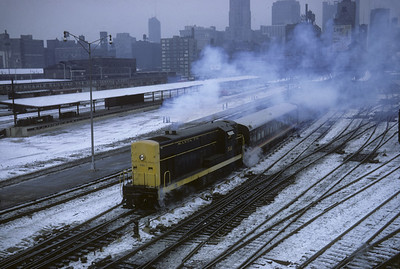 2016.020.07.10--jim neubauer 35mm kodachrome--AT&SF--ALCO diesel switcher locomotive switching passenger cars at Dearborn Station action scene--Chicago IL--1967 1230