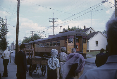2016.020.15.6--neubauer 35mm kodachrome--CSS&SB--electric interurban 101 arriving at station--Michigan City IN--1967 0600