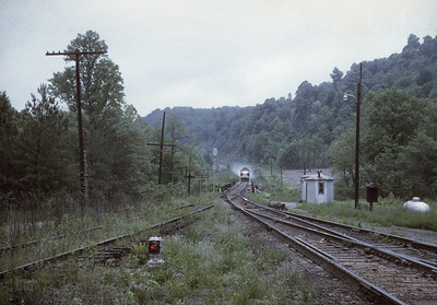 2016.020.23.16--jim neubauer 35mm kodachrome--SOU--EMD diesel locomotive on Carolina Special passenger train descending Saluda grade--Melrose NC--1968 0500