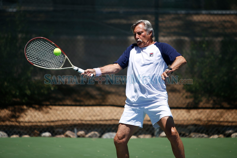 Santa Fe resident and stud tennis player Jimmy Parker practices at Santa Fe Tennis and Swim Club on Friday, May 25, 2018. Parker has been competing in the sport for more than 60 years and has accumulated many trophies and awards. Luis Sánchez Saturno/The New Mexican