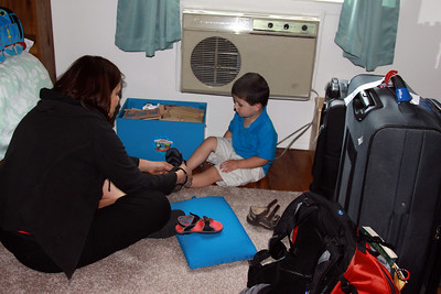 Aunt Peg helping Jack with his Nike sandals