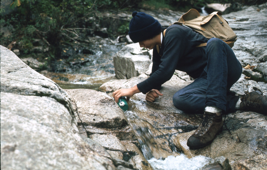 Frank gathering water from a refreshing mountain stream - always a requirement for hiking and climbing.