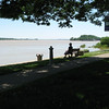 Confluence of the Tennessee and Ohio Rivers at Paducah KY. The rivers are at 'high water' stage - normally an auto road, pedestrian walks and boating dock are visible.