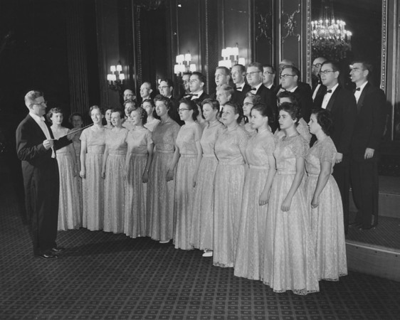 The MAGNAVOX Chorus, sponsored by the MAGNAVOX Company to promote audio products, won first prize at a Chicago Music Festival in the late 1950s. I am in the center, behind and slightly to the left of the lady with glasses in the front row.