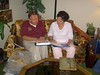 During the summer of 2005, I created the Lacey Family Scrapbook - a history of the Southbridge, MA Lacey family. Photos, letters, articles etc. were collected from my Brother John V. Lacey and my sister Joan [Lacey] Tallman. Here I am presenting a copy to sister Joan at her home in Idaho Falls, ID.