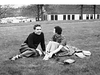 "Jim Lacey III and Mary Bonini meeting on Carnegie Tech ""Cut"" (campus lawn) between classes - early 1950's before they were married."