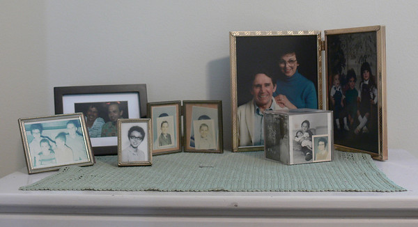A bedroom dresser collection of photos - some more than 50 years old, some faded but all with memories.