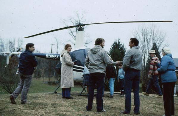 As a birthday gift my son Jim IV, then a heliocopter pilot, landed in our back yard and took me for a ride to the hills of central Massachusetts. Jim is at right shaking hands with neighbor. A most exciting birthday!