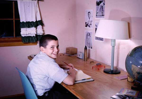 Francis Patrick Lacey [Frank] at his Westford MA bedroom desk. We used standard hollow doors with added folding legs  to create the desk. The lamp is  200 watt unit with plenty of light.