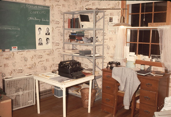 An updated version of my office in Westford MA. Note the 'typewriter' (I believe that what it was called) on the card table. The family photos on the chalkboard were made with my photo development equipment in the basement.