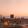 Sunsets in Yazd. The chimney like structures are to aid in the cooling of the air coming in and allows hot air to escape from inside.