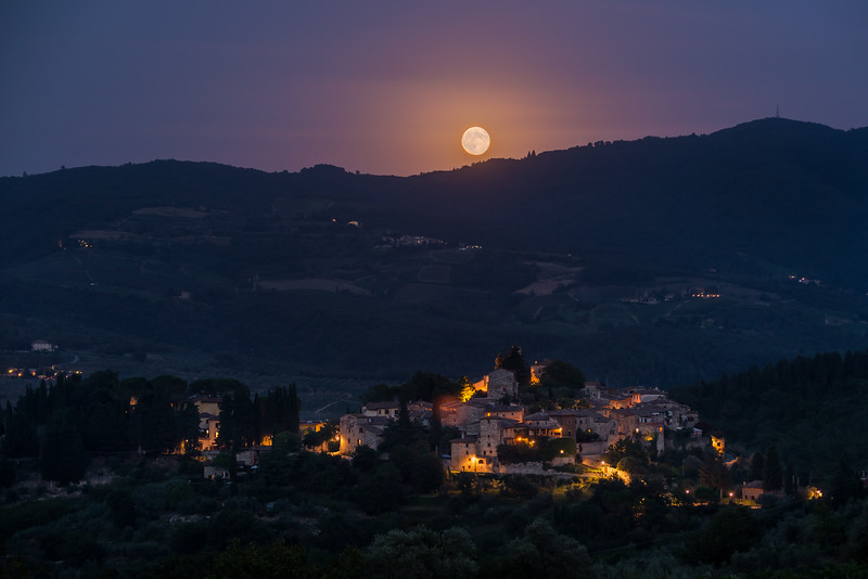 A full moon rises over Montefioralle in the Chianti region.