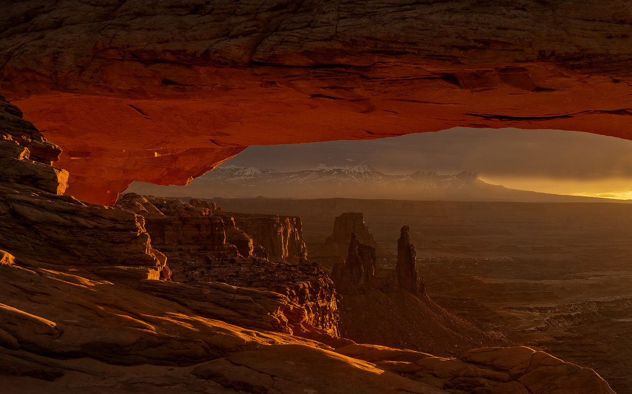 Under Mesa Arch during sunrise in Canyonlands, Utah.