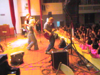 We were rock-stars for one night.  A screen capture from a video of a concert at an all-girls school.
