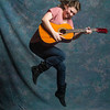 Female Jumping Guitarist