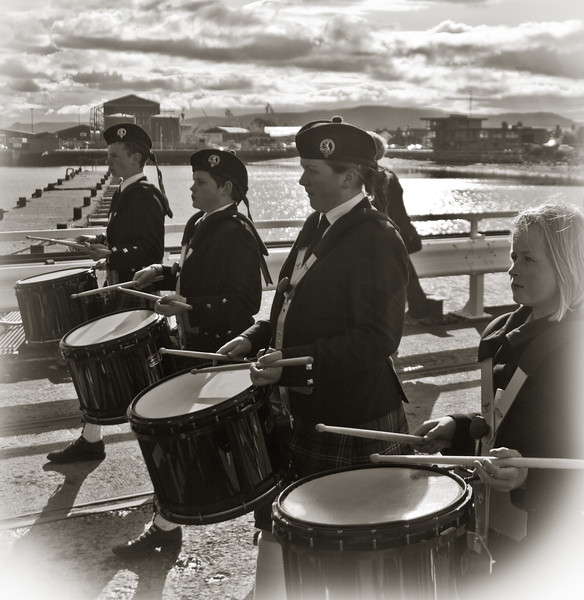 Black and White bagpipers in scotland