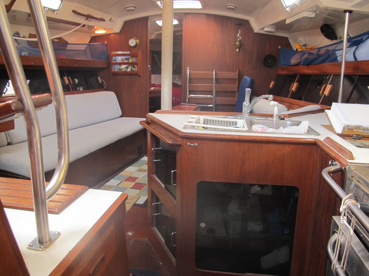 View of the main cabin standing to the right of the companionway.