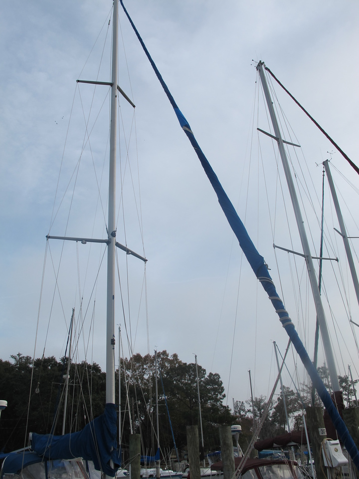 Main mast with swept back spreaders. Jib is rolled up on a Harken roller furler