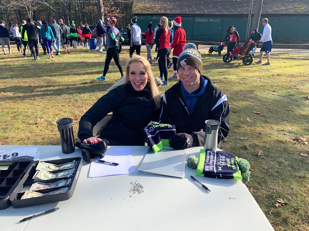 . Julie and Jack Erickson of Westford work the registration table.