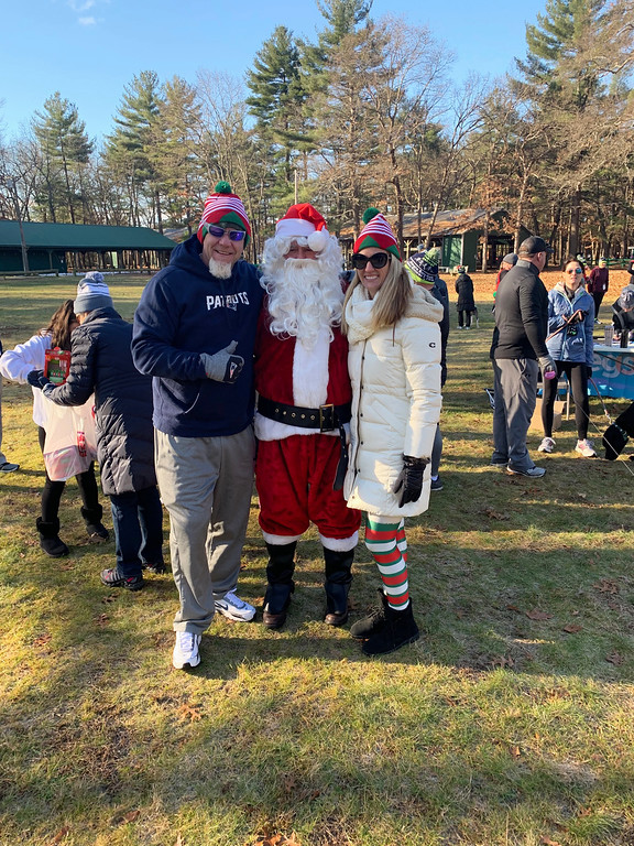 . Santa (who was brought to the event by his good buddy Bob Lefaiver of Windham, N.H.), hangs with two from the nice list � 50 Legs founder Steve Chamberland of Tampa, Fla., and 50 Legs Fundraising Coordinator/Director Tiffiny Willis of Lithia, Fla.