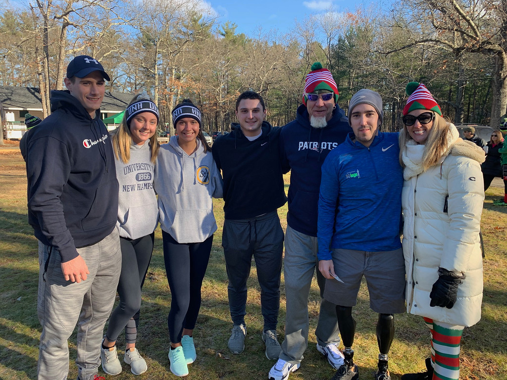 . From left, Alan Bauman, Leah Hidenfelter and Maddie Leach, all of New Hampshire, 50 Legs founder Steve Chamberland of Tampa, Fla., Boston Marathon bombing survivor Jeff Bauman of Carlisle and 50 Legs Fundraising Coordinator/Director Tiffiny Willis of Lithia, Fla.