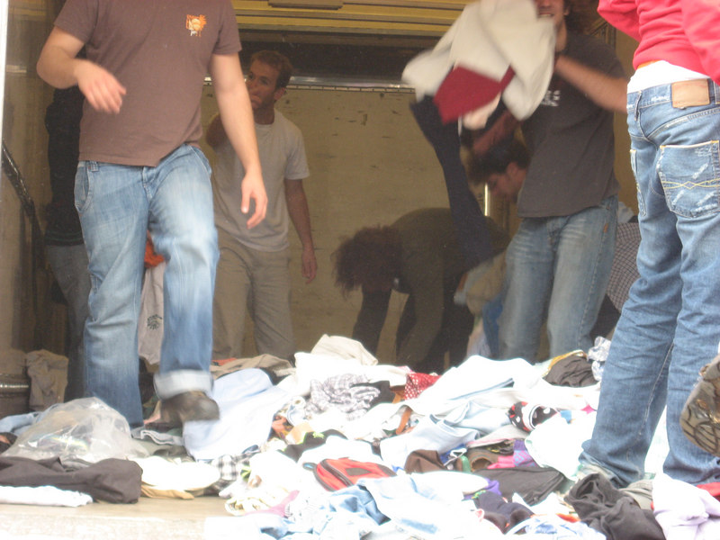 Unloading a truckload of used clothing