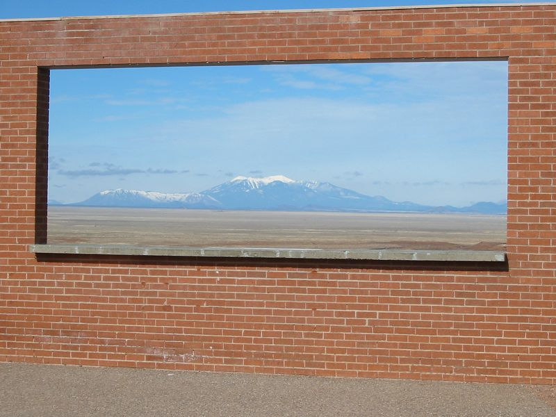 Outdoor picture window with view of the San Francisco Peaks at the Meteor Crater