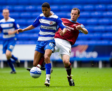 READING, ENGLAND- August 7: Jobi McAnuff of Reading FC battles with Sam Togwell of Scunthorpe United FC during The npower Championship match between Reading FC and Scunthorpe United FC at the Madejski Stadium on August 7, 2010. (Photo by Ben Hoskins/ Reading FC)
