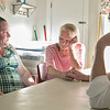 Joe Kennedy III visited Our Father's House in Fitchburg on Saturday afternoon, September 21, 2019. Kennedy listens to Kristi and Leslie two female resident of the shelter. Leslie tells how she just lost her husband an Kennedy reaches over to hold her hand and comfort her. ENTINEL & ENTERPRISE/JOHN LOVE