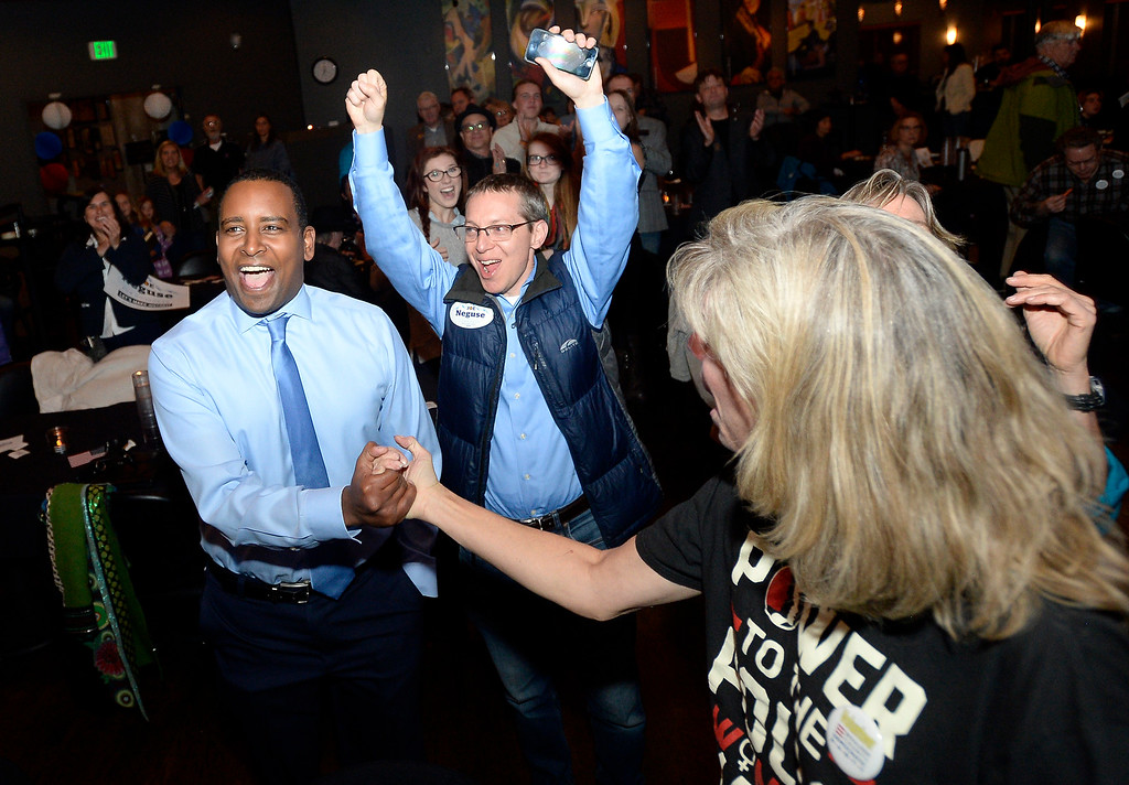 . BOULDER, CO - NOVEMBER 6, 2018: Joe Neguse, at left,   Neal Lurie and Pam Malzbender react after seeing the first-round of results during a democratic watch party at Nissi\'s Entertainment Venue and Event Center on Tuesday night in Lafayette. Neguse is running for the U.S. House of Representatives from Colorado\'s 2nd district. More photos of election night go to dailycamera.com (Jeremy Papasso/Staff Photographer)