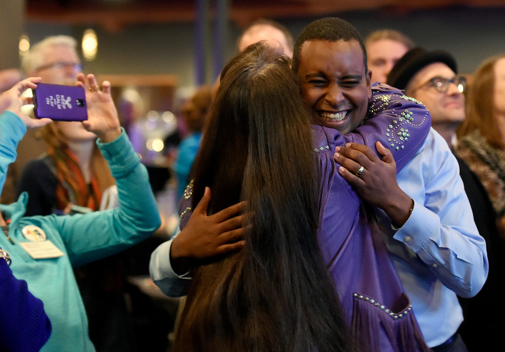 . BOULDER, CO - NOVEMBER 6, 2018: Joe Neguse hugs Sonya Jaquez Lewis reacts after seeing the first-round of results during a democratic watch party at Nissi\'s Entertainment Venue and Event Center on Tuesday night in Lafayette. Neguse is running for the U.S. House of Representatives from Colorado\'s 2nd district and Lewis is running for the  Colorado House of Representatives to represent District 12. More photos of election night go to dailycamera.com (Jeremy Papasso/Staff Photographer)