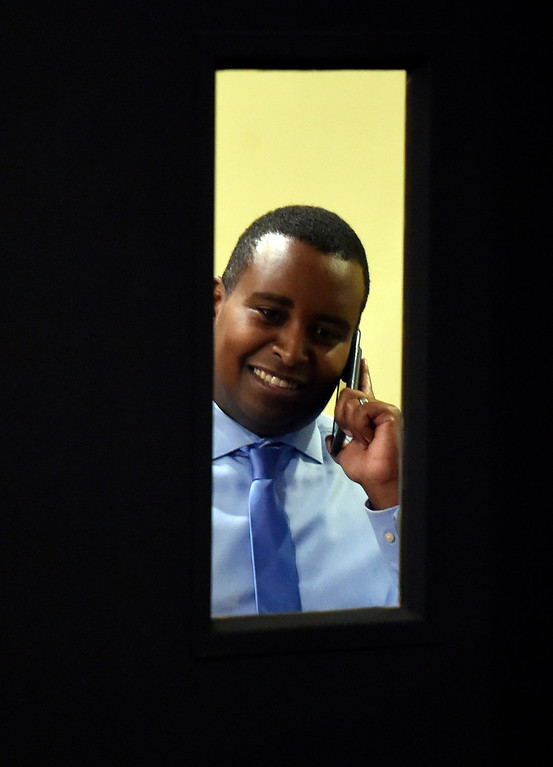 . BOULDER, CO - NOVEMBER 6, 2018: Joe Neguse talks on his phone behind a closed door after seeing the first-round of results during a democratic watch party at Nissi\'s Entertainment Venue and Event Center on Tuesday night in Lafayette. Neguse is running for the U.S. House of Representatives from Colorado\'s 2nd district. More photos of election night go to dailycamera.com (Jeremy Papasso/Staff Photographer)