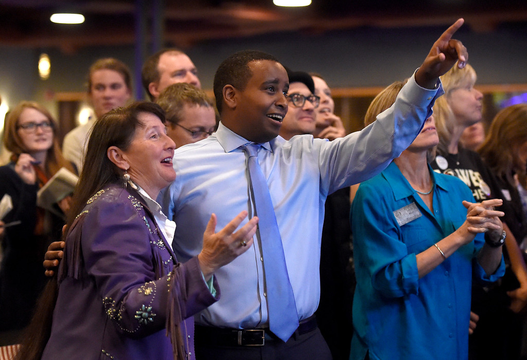 . BOULDER, CO - NOVEMBER 6, 2018: Joe Neguse and Sonya Jaquez Lewis, at left, react after seeing the first-round of results during a democratic watch party at Nissi\'s Entertainment Venue and Event Center on Tuesday night in Lafayette. Neguse is running for the U.S. House of Representatives from Colorado\'s 2nd district and Lewis is running for the  Colorado House of Representatives to represent District 12. More photos of election night go to dailycamera.com (Jeremy Papasso/Staff Photographer)