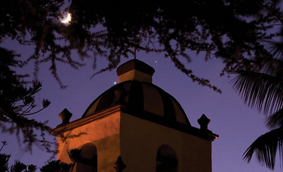 Ventura Mission Tower with a rare convergence of the moon, Venus and Jupiter.